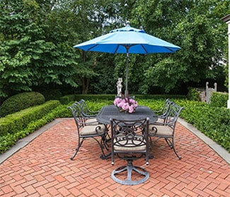 red brick patio set in herringbone pattern