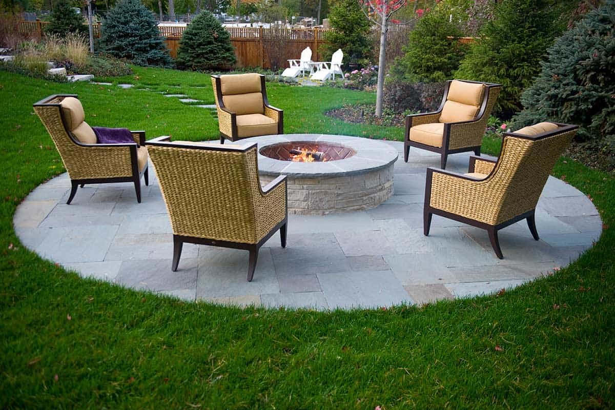 raised-fire-pit-on-circular-bluestone-patio