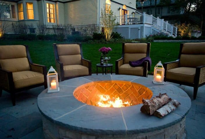 raised-stone-firepit-at-night