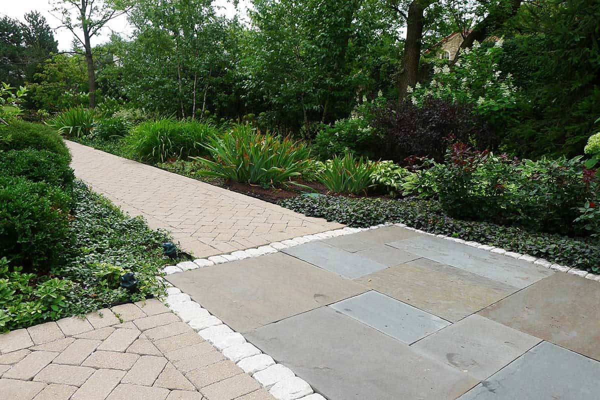 intersecting-concrete-paver-path-and-bluestone-landing